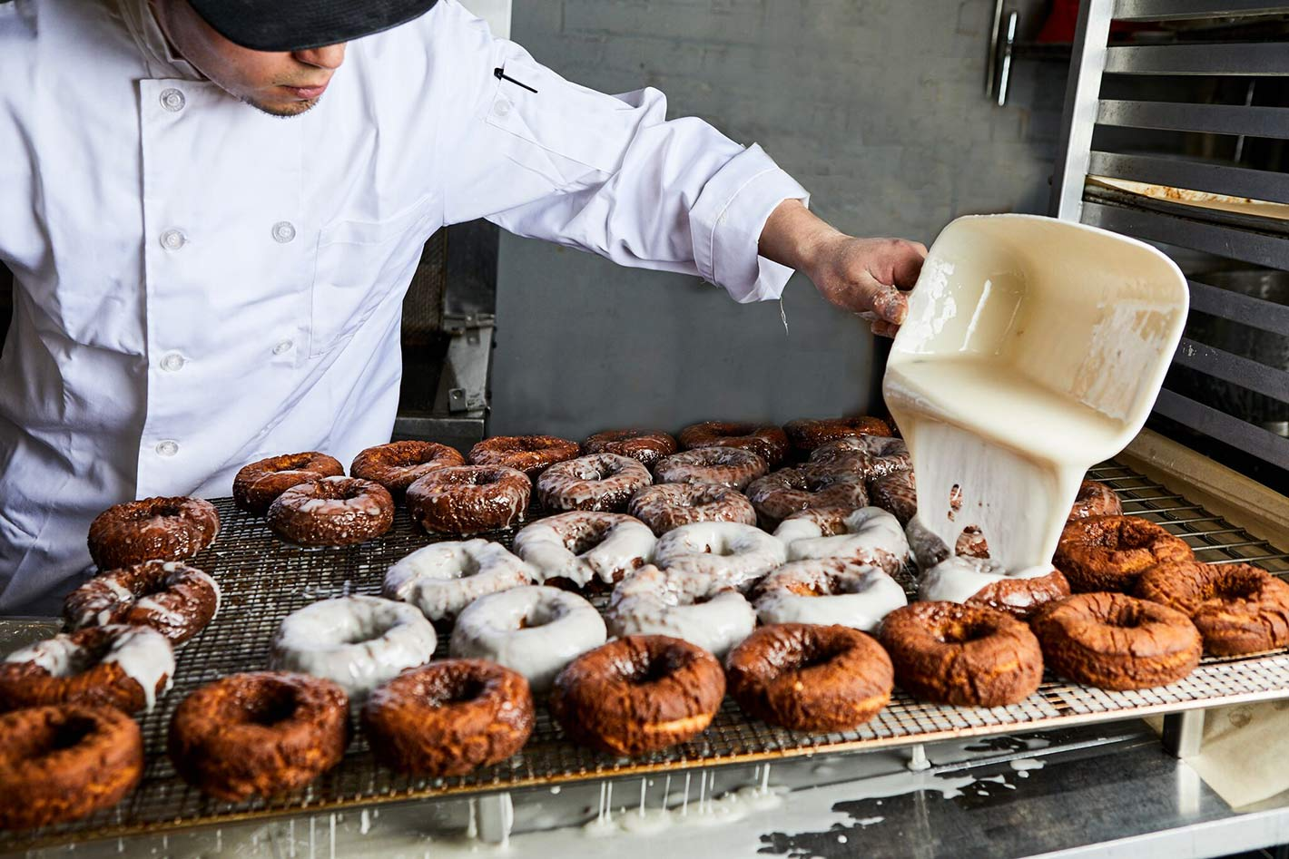 Pouring glaze on donuts