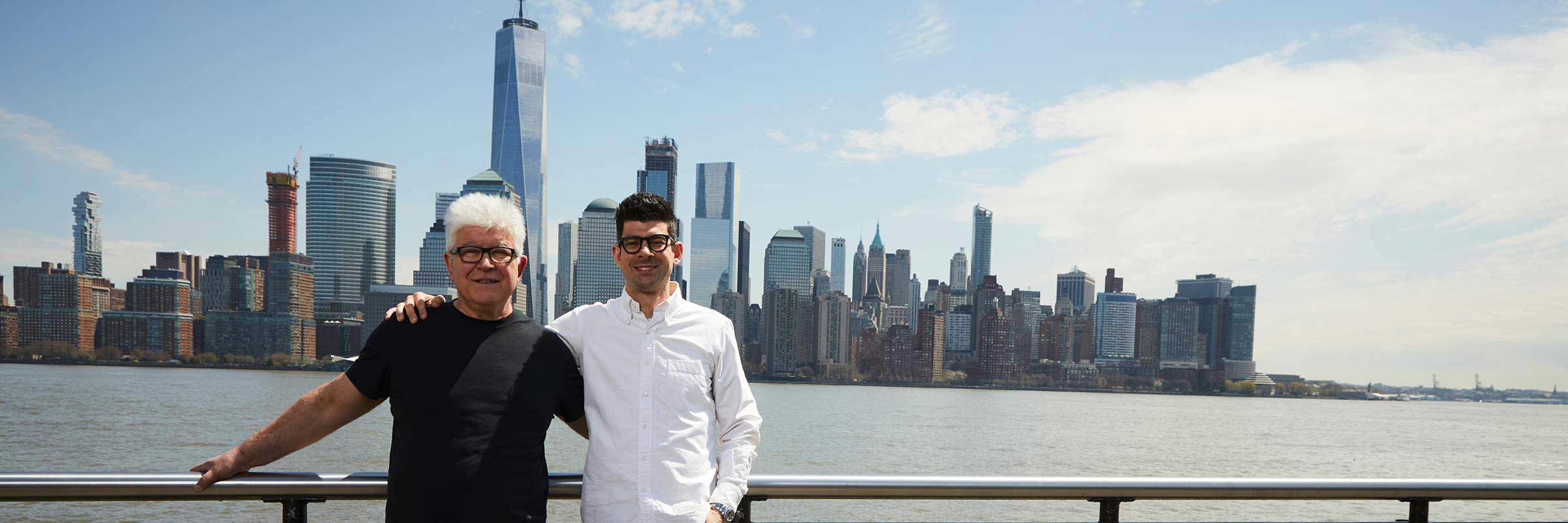 Gregory and Father in front of NYC skyline